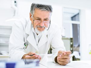 Scientist analyzes the samples in the laboratory.