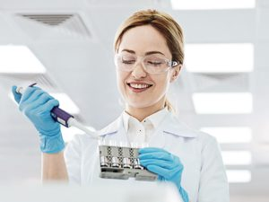 The Best Possible Exome. CeGaT. A scientist analyzes the samples in the laboratory.