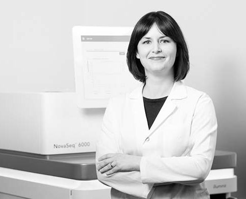 Professional female scientist standing in front of Illumina® NoveSeq™ 6000. Whole Genome Sequencing