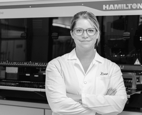 Small RNA Sequencing. Female Scientist in front of Hamilton Microlab® STAR